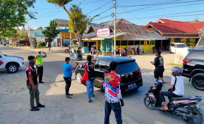 Gandeng Kepolisian, ARCI Gorontalo Bagikan Masker Gratis